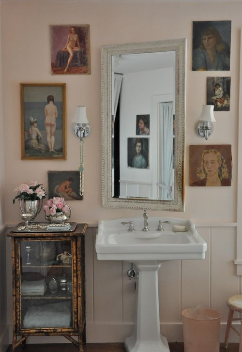Velvet and Linen's pink bathroom with Farrow & Ball Pink Ground paint color, vintage portrait gallery and pedestal sink. Come see the Best Sophisticated, Chic and Subtle Pink Paint Colors on Hello Lovely Studio!