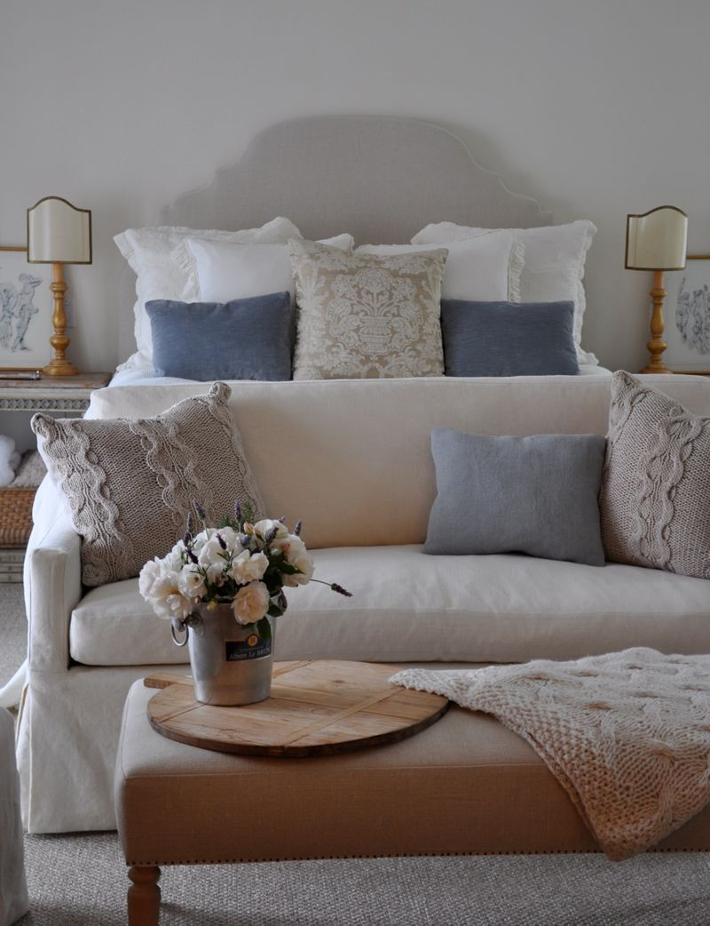 A beautiful neutral master bedroom design in process for End of bed sofa