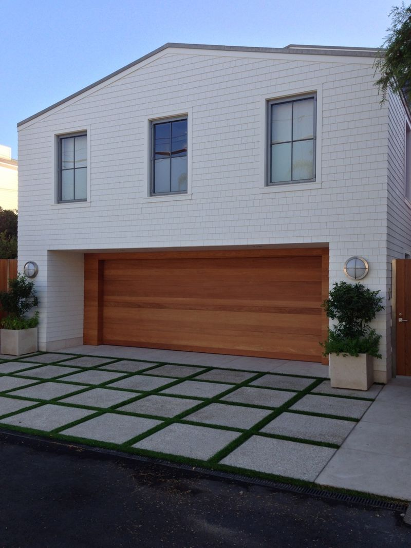 A new giannetti home project modern shingle style beach for Stylish garage doors