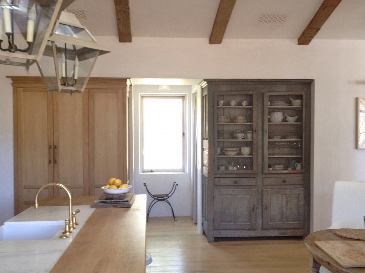 Grey painted antique French tall cabinet in #PatinaFarm modern farmhouse kitchen with white oak and #rusticdecor