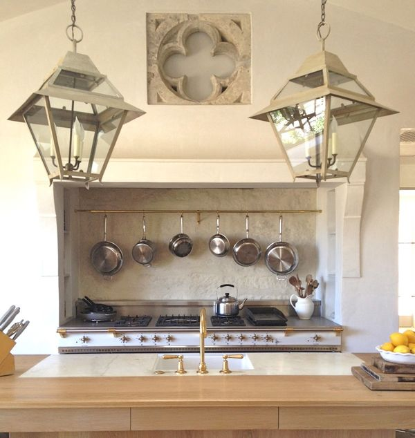 Farmhouse hanging lanterns over an island in a #farmhousekitchen with #FrenchCountry style and #rusticdecor