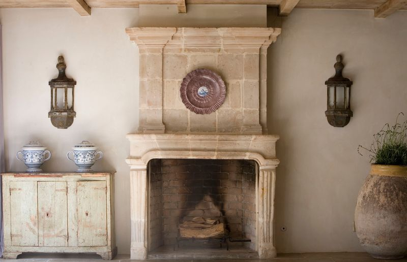 Chateau Domingue - Ruth Gay's home with antique stone fireplace