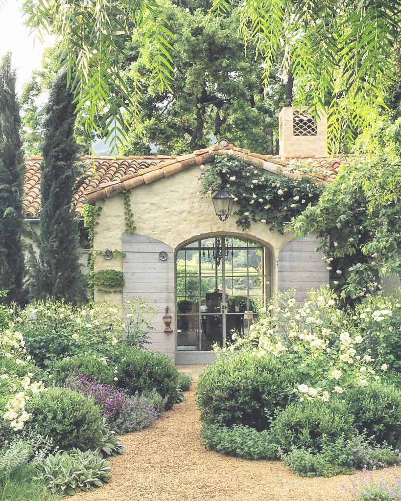 Lush gardens surrounding the modern farmhouse with French Country style, Patina Farm. #patinafarm #frenchfarmhouse #frenchcountry #gardeninspiration #cottagestyle #cottagegarden